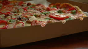 Delicious pizza in a box stock video footage