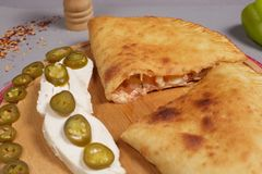 Delicious pizza calzone. stock images