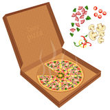 Delicious pizza in a cardboard box. Royalty Free Stock Photography