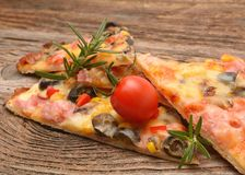 Delicious pizza with cheese and cherry tomatoes on wooden table Royalty Free Stock Image