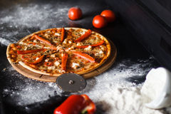Delicious pizza with cheese and vegetables on black background Stock Photo