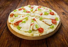 Delicious pizza with chicken - Caesar style Royalty Free Stock Photography