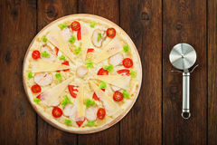 Delicious pizza with chicken and cutter near Stock Photos