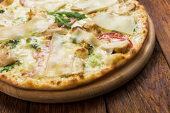 Delicious pizza with chicken, parmesan and fresh arugula Royalty Free Stock Images