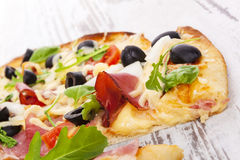 Delicious pizza detail. Royalty Free Stock Images