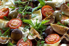 Delicious pizza food background. Delicious pizza food background with appetite ingredients, tomato,basil,cheese,fig,herbs,olives. Close up royalty free stock photography