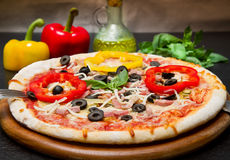A Delicious Pizza with Fresh pepper and olives Royalty Free Stock Images