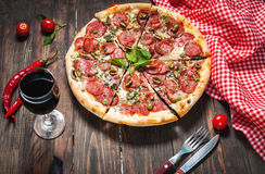 Free Delicious Pizza, Glass Of Wine Vegetables And Spices On Wooden Table Royalty Free Stock Image - 90713926