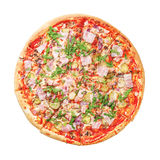 Delicious pizza with ham and arugula on white. Top view. Delicious pizza with ham and arugula isolated on white background. Top view royalty free stock images