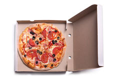 Delicious pizza with ham and tomatoes in box Royalty Free Stock Image