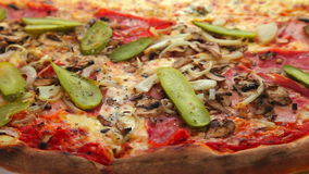 Delicious pizza with ham and vegetables stock video