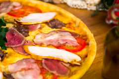 Delicious pizza. Delicious homemade italian pizza for food delivery Stock Photos