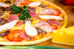 Delicious pizza. Delicious homemade italian pizza for food delivery Royalty Free Stock Images