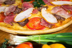Delicious pizza. Delicious homemade italian pizza for food delivery Royalty Free Stock Photography
