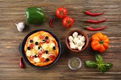 Delicious pizza with ingredients Royalty Free Stock Photography