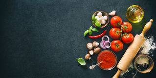 Delicious pizza with ingredients and spices. Top view with copy space on wooden table Stock Images