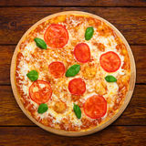 Delicious pizza with mozarella and tomatoes - Margherita Stock Image