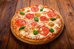 Delicious pizza with mozarella and tomatoes - Margherita Stock Photography