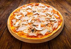 Delicious pizza with mushrooms and smoked chicken Stock Photography