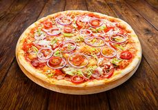 Delicious pizza with onions, bacon and cherry tomato Stock Photography