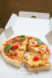 Delicious pizza in paper box Royalty Free Stock Photos