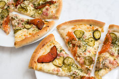 Delicious pizza on plate. Delicious pizza on white plate Stock Photo