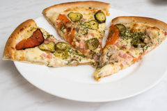 Delicious pizza on plate. Delicious pizza on white plate Royalty Free Stock Photo