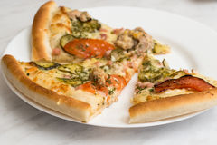 Delicious pizza on plate. Delicious pizza on white plate Royalty Free Stock Photography