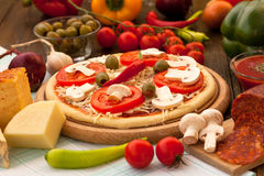 Delicious pizza ready for baking Royalty Free Stock Photo