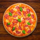 Delicious pizza with salami and cherry tomatoes Stock Photo
