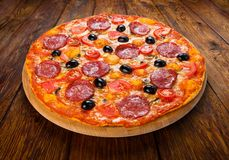 Delicious pizza with salami, mushrooms and olives Royalty Free Stock Images