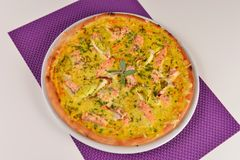 Delicious pizza with salmon Stock Images
