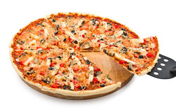 Delicious Pizza with seafood with cut off slice Royalty Free Stock Photos