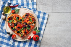 Delicious pizza served on white wooden table. Stock Photos
