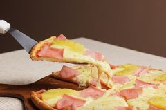 Delicious pizza served on wooden plate  - Imagen stock photos