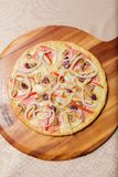 Delicious pizza served on wooden plate  - Imagen stock photo