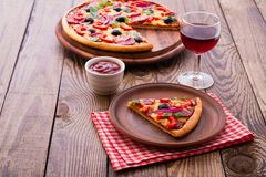 Delicious pizza served on wooden table Stock Image