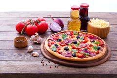 Delicious pizza served on wooden table Royalty Free Stock Photo