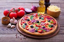 Delicious pizza served on wooden table Stock Photos