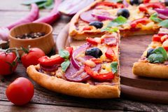 Delicious pizza served on wooden table Stock Photo