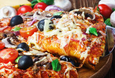 Delicious pizza served on wooden table Royalty Free Stock Images
