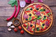 Delicious pizza served on wooden table top view Stock Image