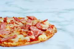 Delicious pizza on white marble background royalty free stock photos