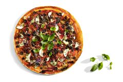 Delicious Pizza on white table Stock Photography