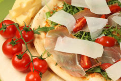 Delicious pizza on wooden plate Stock Photography
