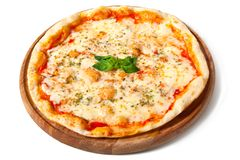 Delicious pizza on a wooden plate on white stock photos