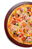 Delicious pizza on wooden tray royalty free stock photography