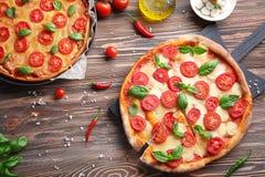 Delicious pizzas on  table. Delicious pizzas on kitchen table Stock Photos