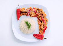 Delicious Plate. 2 red pepper chicken  and rice with dill in white plate Royalty Free Stock Photos