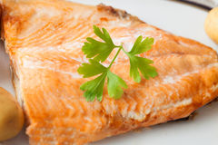 Delicious plate of baked salmon Stock Photo